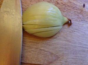 Make 3 incisions through the onion.