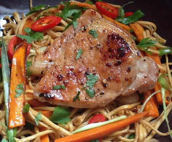 Pork chops with stir fried noodles