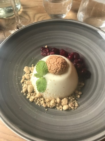 Amaretto panna cotta with summer berries and coffee crumble